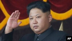 FILE - North Korean leader Kim Jong Un gestures as he watches a military parade in Pyongyang, North Korea.