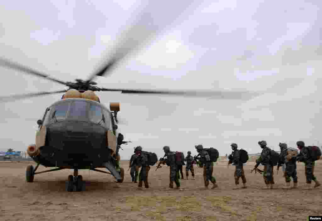 Afghan National Army soldiers board a helicopter to reinforce security ahead of presidential polls in Mazar-I-Shariff, April 2, 2014.