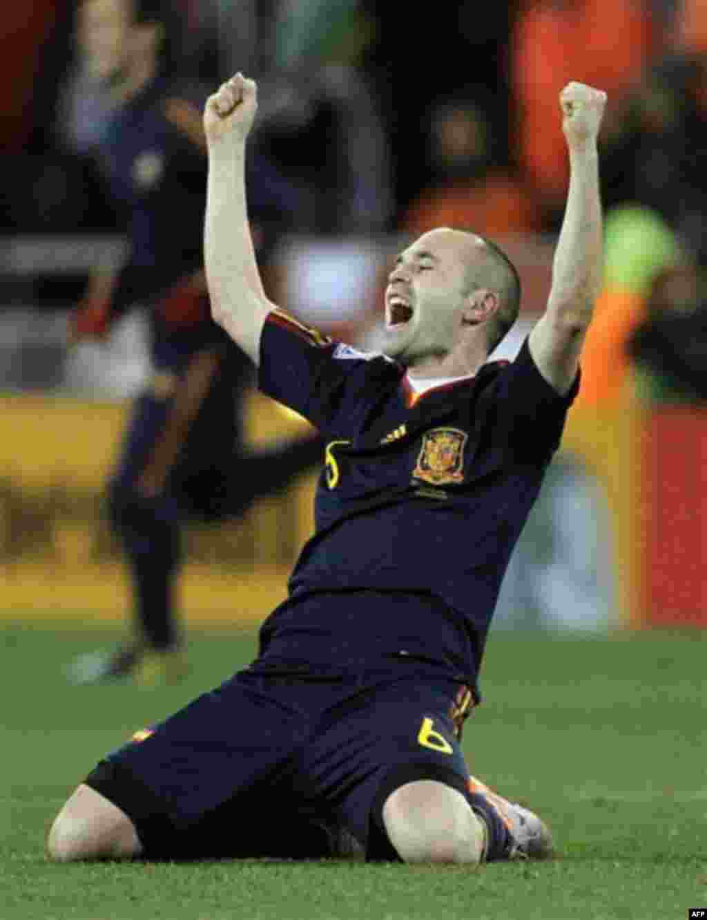 Spain's Andres Iniesta celebrates after scoring a goal during the World Cup final soccer match between the Netherlands and Spain at Soccer City in Johannesburg, South Africa, Sunday, July 11, 2010. Spain won 1-0. (AP Photo/Matt Dunham)