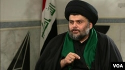 Shi'ite cleric Moqtada al-Sadr speaks with the Alhurra television network.