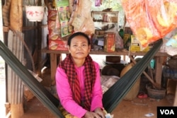 Pen Samath, 52, who owns a small shop along the road in Chantrey commune, said she can no longer communicate with ex-opposition officials, Feb. 14, 2018. (Sun Narin/VOA Khmer)