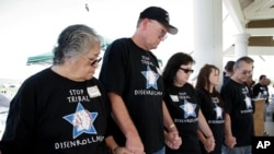 FILE - Protesters hold hands in prayer in Temecula, Calif., at a rally protesting the disenrollment of tribal members, Saturday, May 21, 2005. More than a hundred ousted members of tribes from California and five other states gathered to denounce being di