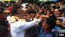 """Three days, we'll rally, from day to night,"" Sam Rainsy told a crowd of some 1,000 people outside a Phnom Penh market on Tuesday. ""We will march throughout the city."""