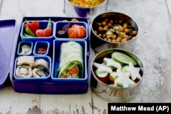 A Japanese bento box and Indian food container offer a multinational styles for lunch containers. (AP Photo)