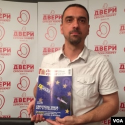 Jugoslav Kiprijanovic of the pro-Russian Dveri movement. The group's magazine cover equates EU membership to suicide for Serbia. (Photo: L. Ramirez / VOA)