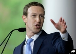 FILE - Facebook CEO Mark Zuckerberg delivers the commencement address at Harvard University, May 25, 2017, in Cambridge, Massachusetts.