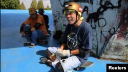 Yoshio Kinoshita takes a break during his skateboarding practice at a park in Daito, Osaka Prefecture, Japan October 6, 2021. (REUTERS/Akira Tomoshige)