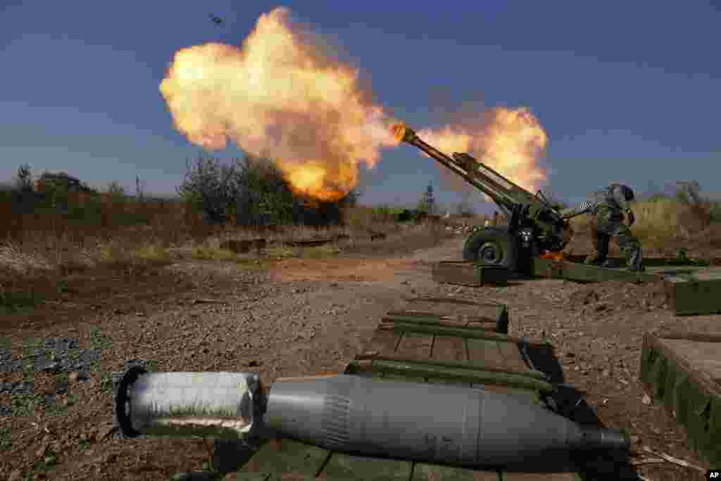 Pro-Russian rebels fire artillery toward Ukrainian position at Donetsk Sergey Prokofiev International Airport on the outskirts the city of Donetsk, eastern Ukraine, Oct. 14, 2014.