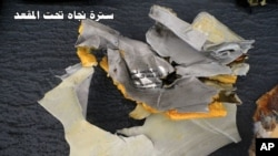 This picture posted Saturday, May 21, 2016, on the official Facebook page of the Egyptian Armed Forces spokesman shows a life vest from EgyptAir flight 804.