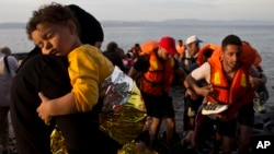 Syrian refugees arrive on a dinghy after crossing from Turkey to Lesbos island, Greece, Sept. 9, 2015.