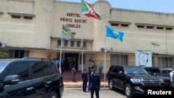 FILE - Security officials keep watch outside the Prince Regent Charles Hospital as Burundi's Prime Minister Alain-Guillaume Bunyoni visits the victims of an explosion, in Bujumbura, Burundi, September 21, 2021.