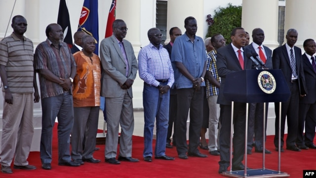 This picture released by the Kenya presidential service shows Kenyan President Uhuru Kenyatta speaking during a press conference with the seven detainees released to his custody by South Sudan President after addressing a press conference at State House in Nairobi, Jan. 29, 2014.