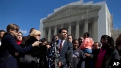 FILE - Debo Adegbile, special counsel, NAACP Legal Defense Fund, outside the Supreme Court, Washington, Feb. 27, 2013.