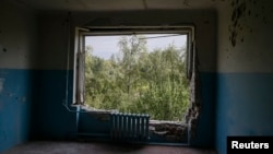 A room in a hospital, which was damaged during fighting between the Ukrainian army and pro-Russian separatists, is seen in Avdiyivka near Donetsk, Sept. 8, 2014.