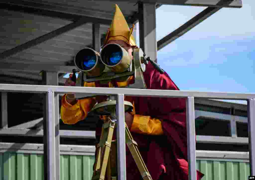 A Buddhist monk watches the Vostok-2018 (East-2018) military drills at Tsugol training ground, not far from the borders with China, and Mongolia in Siberia.