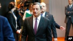 President of European Central Bank Mario Draghi is on his way to a news conference in Frankfurt, Germany, Thursday, Sept. 4, 2014, following a meeting of the ECB governing council.