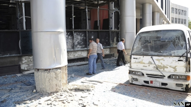 Photo released by Syria's national news agency shows wreckage of a bus after a bombing in the al-Zablatani area, Damascus, October 9, 2012.