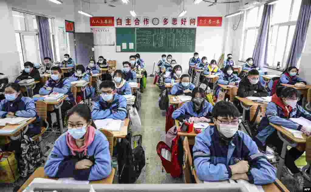 Students return to school  after the term opening was delayed due to the COVID-19 coronavirus outbreak, in Huaian in China's eastern Jiangsu province.