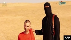 FILE - British aid worker David Haines in an image taken from a video released by the Islamic State group (IS), Sept. 2, 2014.