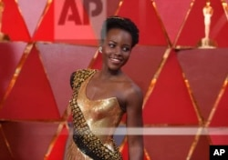 FILE - Lupita Nyong'o arrives at the Oscars at the Dolby Theatre in Los Angeles, March 4, 2018.