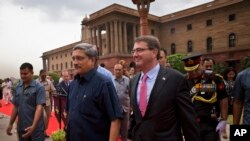 U.S. Defense Secretary Ashton Carter, right, walks with Indian Defense Minister Manohar Parrikar after receiving a ceremonial welcome in New Delhi, India, Wednesday, June 3, 2015