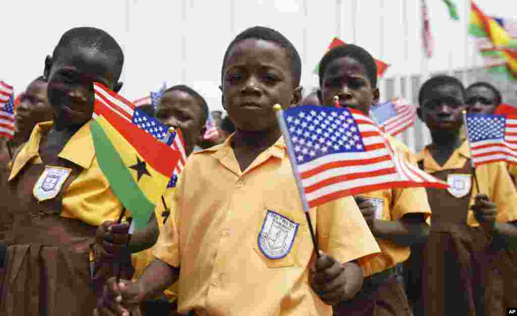 Children waves American and Ghana flags during an arrival ceremony for First lady Melania Trump at Kotoka International Airport in Accra, Ghana, Oct. 2, 2018.