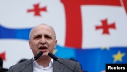 FILE - Vano Merabishvili, leader of opposition United National Movement party, addresses people during a rally in Tbilisi.
