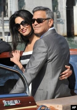 George Clooney and his fiancee Amal Alamuddin arrive in Venice, Italy, Sept. 26, 2014.
