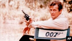 FILE - British actor Roger Moore, playing the title role of secret service agent 007, James Bond, is shown on location in England in 1972. Moore, played Bond in seven films, more than any other actor.