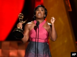 """Uzo Aduba accepts the award for outstanding supporting actress in a drama series for """"Orange Is The New Black"""" at the 67th Primetime Emmy Awards at the Microsoft Theater in Los Angeles, Sept. 20, 2015."""