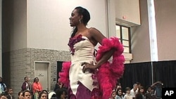 A model showcases a wedding gown made completely of recycled materials at the seventh annual Green Festival in Washington, DC.