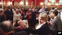 "Members of ""Yes We Can: Middle East Peace"" dance together at a historic synagogue in downtown Washington DC"