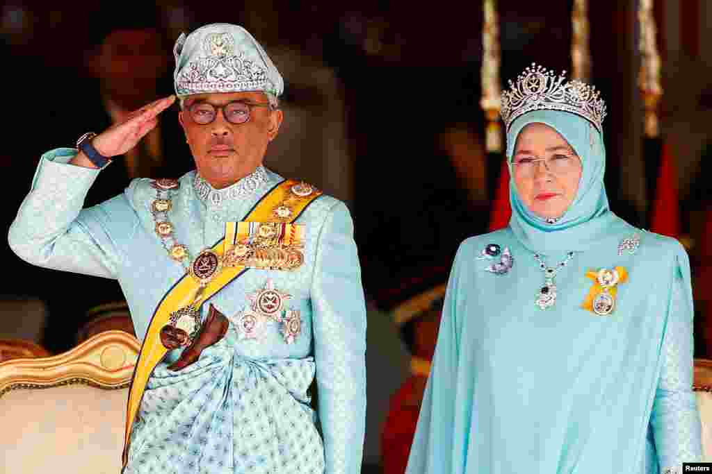 Malaysia's new king, Sultan Abdullah Sultan Ahmad Shah, and queen, Tunku Azizah Aminah Maimunah, attend a welcoming ceremony at the Parliament House in Kuala Lumpur.