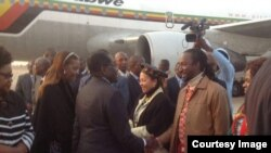 FILE: President Robert Mugabe with First Lady Grace Mugabe greeting some cabinet ministers and close relatives recently soon after his arrival from the United Nations General Assembly in New York. Partly obscured (left) is Vice President Joice Mujuru.