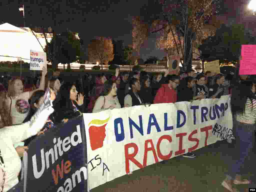"Demonstrators protesting the election of Donald Trump chanted ""Undocumented and unafraid"" as they marched near the White House in Washington, D.C., Nov. 10, 2016. (Jesusemen Oni/VOA)"