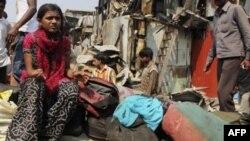 Рубина Али у развалин своего дома