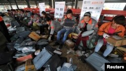 Employees sort packages at a hub of Shentong (STO) Express delivery company in Hefei, Anhui province. China's Singles' Day, which is celebrated annually on November 11, has become the world's largest online shopping day, with online shopping websites offe