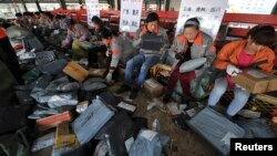 Employees sort packages at a hub of Shentong (STO) Express delivery company in Hefei, Anhui province. China's Singles' Day, which is celebrated annually on November 11, has become the world's largest online shopping day, with online shopping websites offering attractive discounts.