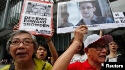 Dân Hồng Kông xuống đường biểu tình ủng hộ Edward Snowden, ngày 13/6/2013.