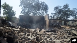 FILE - Destruction left in the wake of an attack by Boko Haram, Bama, Nigeria, Feb. 20, 2014.