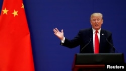 FILE - U.S. President Donald Trump speaks at the Great Hall of the People in Beijing, China, Nov. 9, 2017.
