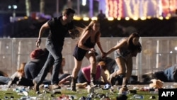 People run from the Route 91 Harvest country music festival after apparent gun fire was hear on Oct. 1, 2017, in Las Vegas, Nevada.