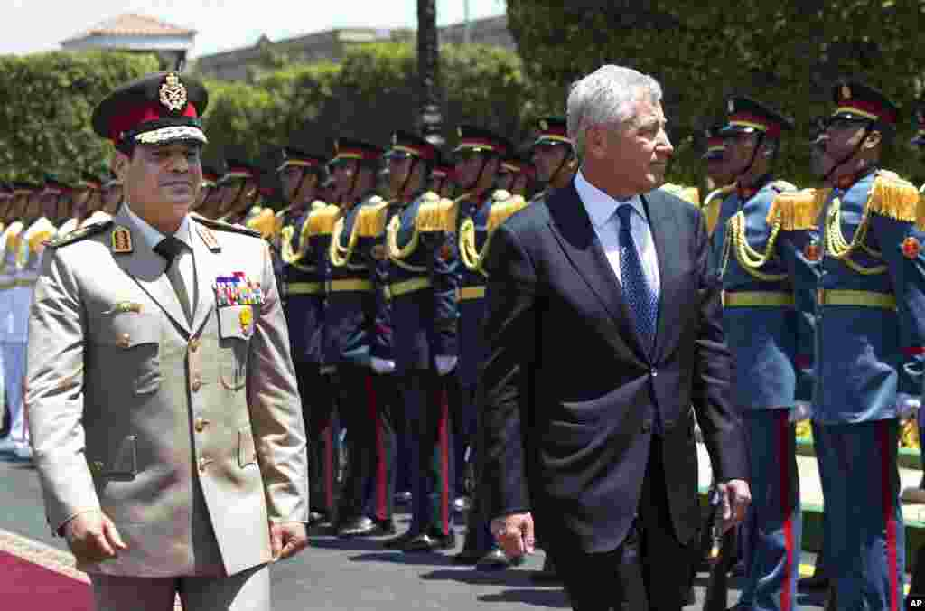 U.S. Secretary of Defense Chuck Hagel walks with Egyptian Defense Minister General Abdel-Fattahal-Sisiduring an arrival ceremony at the Ministry of Defense in Cairo, April 24, 2013.