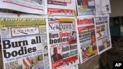 A close-up of newspaper front pages focusing on the Ebola outbreak, including a newspaper, reading 'Burn all bodies' in Monrovia, Liberia, July 31, 2014.