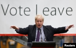 "FILE - London Mayor Boris Johnson speaks at a ""Out"" campaign event, in favor of Britain leaving the European Union, at Europa Worldwide freight company in Dartford, Britain, March 11, 2016."