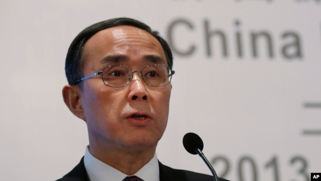FILE - Then Chairman of China Unicom Ltd. Chang Xiaobing speaks at a press conference to announce the company's 2013 earnings in Hong Kong, Feb. 27, 2014. Chang stepped down from his post as chairman of China Telecom after it was announced he is under investigation.