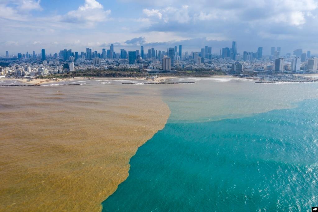 Muddy water from Hayarkon river flows in to the Mediterranean Sea in Tel Aviv, Israel.