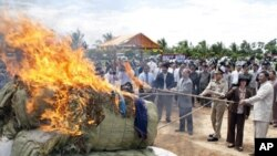 Cambodian officers burn nearly three tones of various drug making substances, which were seized in raids earlier this year in eastern and southern Cambodia.
