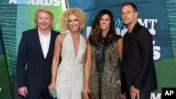 FILE - Phillip Sweet, from left, Kimberly Schlapman, Karen Fairchild and Jimi Westbrook, of Little Big Town, arrive at the CMT Music Awards at Bridgestone Arena in Nashville, Tennessee, June 10, 2015.