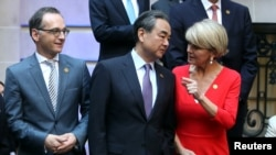 FILE - Australia's FM Julie Bishop talks to her Chinese counterpart, Wang Yi, as Germany's FM Heiko Maas watches, at the G20 Meeting of Foreign Affairs Ministers in Buenos Aires, Argentina, May 21, 2018.